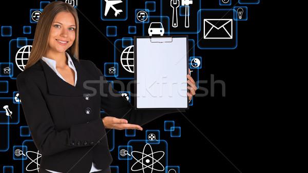 Businesswoman holding paper holder Stock photo © cherezoff