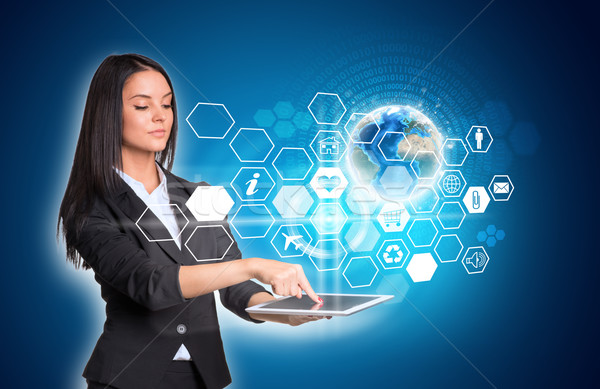 Women using digital tablet and Earth hexagons Stock photo © cherezoff