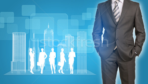 Businessman with wire-frame buildings and business silhouettes Stock photo © cherezoff