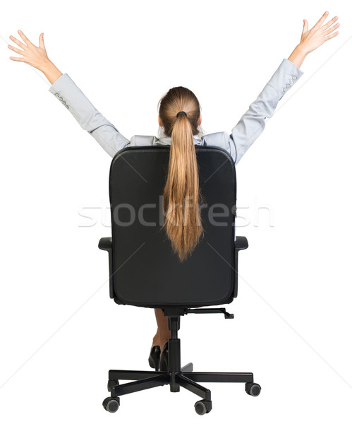Businesswoman stretching in the chair of her office. Back view Stock photo © cherezoff