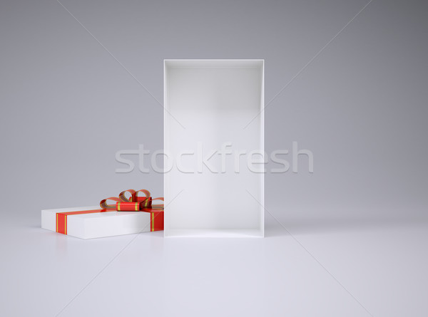 Open gift box and lid with ribbon Stock photo © cherezoff