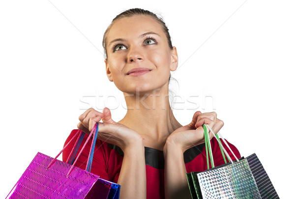 Young lady with smile handing bags. Closed up Stock photo © cherezoff
