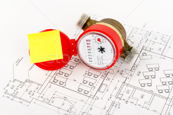 Water meter with sticker on draft, close up view Stock photo © cherezoff
