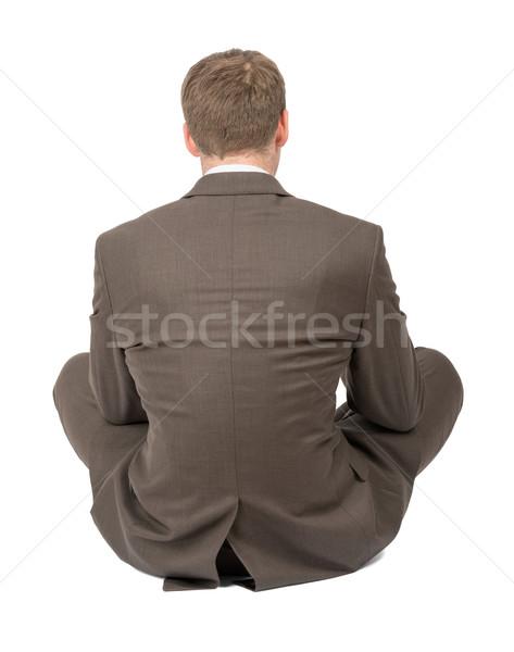 Businessman in lotus posture on white, rear view Stock photo © cherezoff