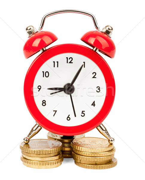 Alarm clock on stack of coins Stock photo © cherezoff