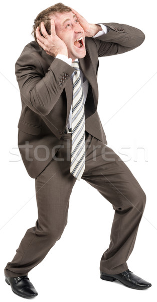 Screaming businessman covering his ears Stock photo © cherezoff