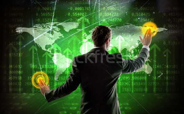 Rear view of businessman touching digital screen Stock photo © cherezoff