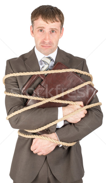 Young businessman tied with ropes Stock photo © cherezoff