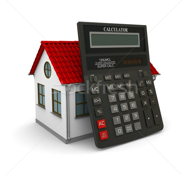 Calculator leaned on a little house with red roof Stock photo © cherezoff