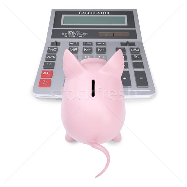 Pink piggy bank on a calculator Stock photo © cherezoff