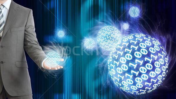 Empresário terno manter esferas dígitos Foto stock © cherezoff