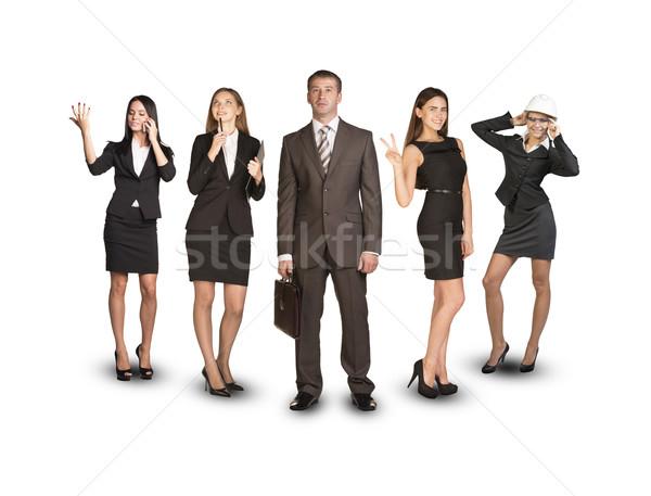 группа деловые люди лидера передний план бизнесмен изолированный Сток-фото © cherezoff