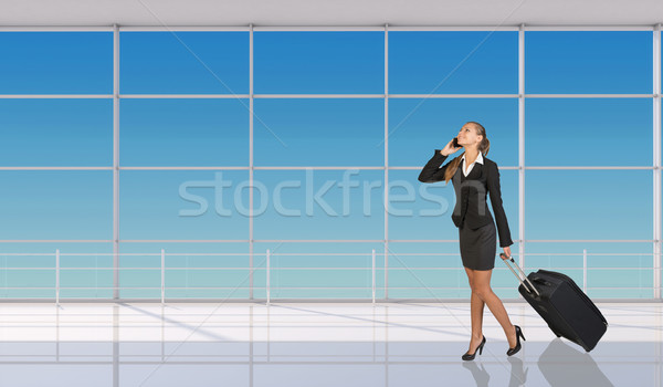 Smiling flight attendant talking on mobile phone Stock photo © cherezoff