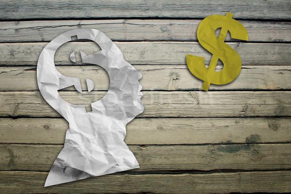 Paper humans head with dollar symbol Stock photo © cherezoff