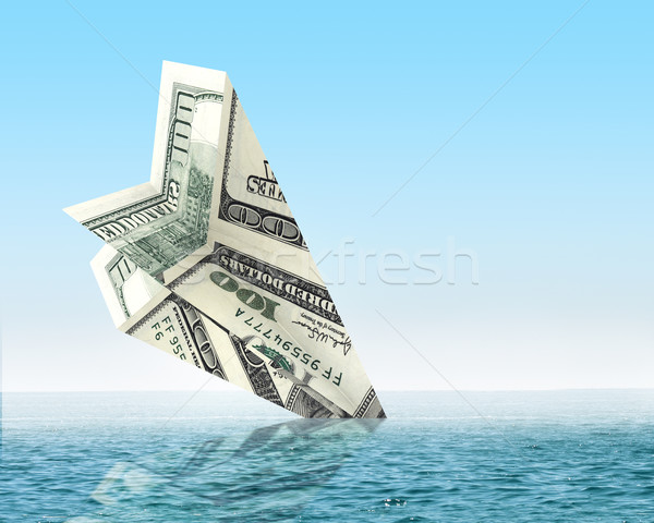Bankruptcy business. Money plane wreck Stock photo © cherezoff