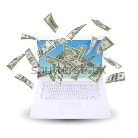 Black laptop with money flow Stock photo © cherezoff