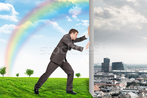 Businessman changing city on nature landscape Stock photo © cherezoff