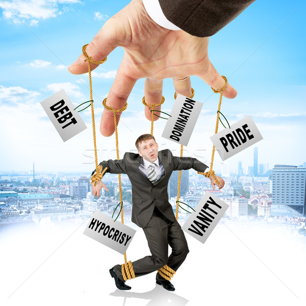 Businessman hanging on strings like marionette Stock photo © cherezoff