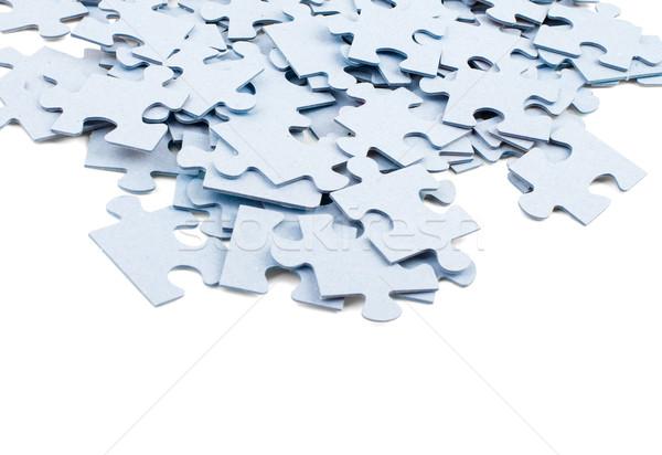 Köteg szürke kirakó darabok izolált fehér üzlet Stock fotó © cherezoff