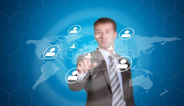 üzletember mutat ujj hálózat ikonok technológia Stock fotó © cherezoff