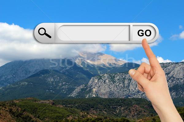 Emberi kéz keresés bár böngésző hegy égbolt Stock fotó © cherezoff
