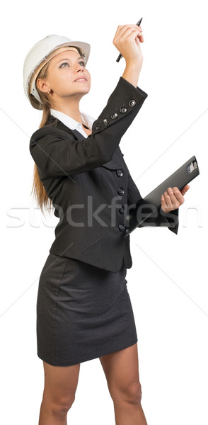 Businesswoman wearing hard hat, holding clipboard, drawing or wr Stock photo © cherezoff