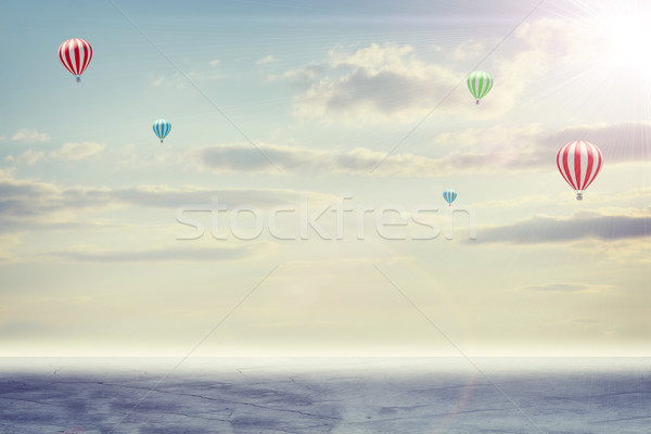 Konkretnych piętrze chmury słońce balonem Zdjęcia stock © cherezoff
