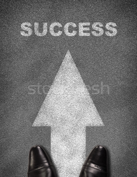 Shoes standing on asphalt road with arrow and word success Stock photo © cherezoff