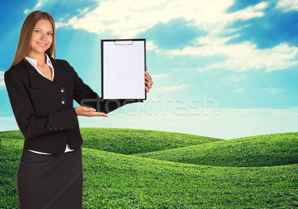 Young woman holding paper holder with nature on background Stock photo © cherezoff