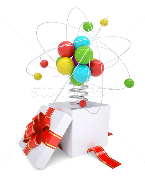 Gift box with red band and colorful atom structure Stock photo © cherezoff