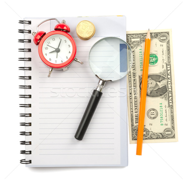 Copybook with loupe and coins Stock photo © cherezoff