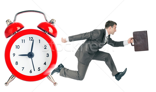 Businessman runaway from alarm clock Stock photo © cherezoff