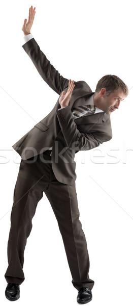 Isolated business man dodge something Stock photo © cherezoff