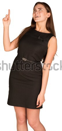 Businesswoman pushing fingers in opposite directions Stock photo © cherezoff