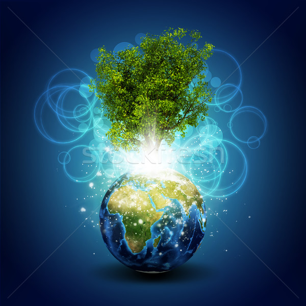 Earth with magical green tree and rays of light Stock photo © cherezoff