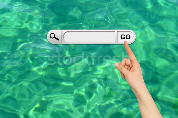 Emberi kéz keresés bár böngésző türkiz víztükör Stock fotó © cherezoff