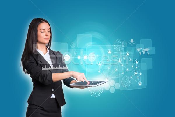 Mujeres digital tableta círculos hermosa empresarias Foto stock © cherezoff
