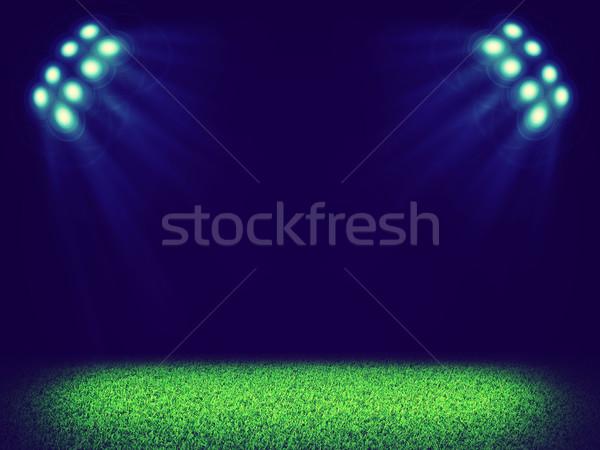Spotlights illuminating area of grass court Stock photo © cherezoff