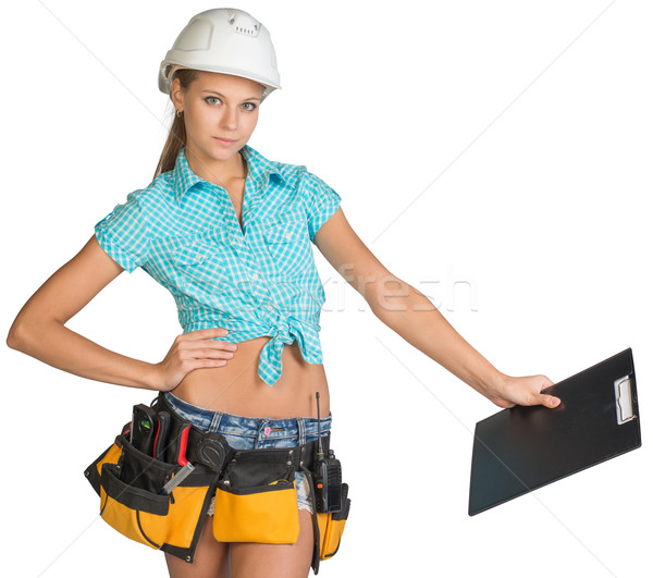 Woman in hard hat and tool belt holding clipboard Stock photo © cherezoff