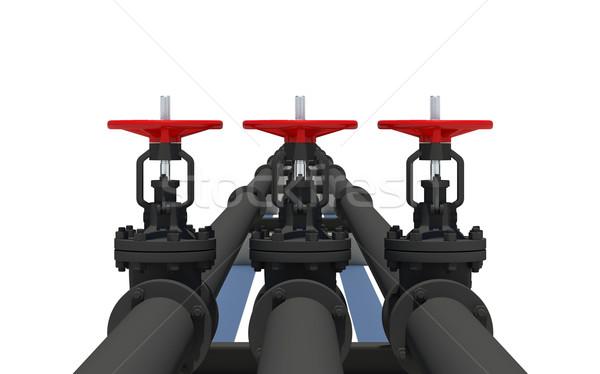 Three black pipes with valves Stock photo © cherezoff