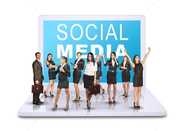 üzletemberek áll laptop nyitva izolált fehér Stock fotó © cherezoff