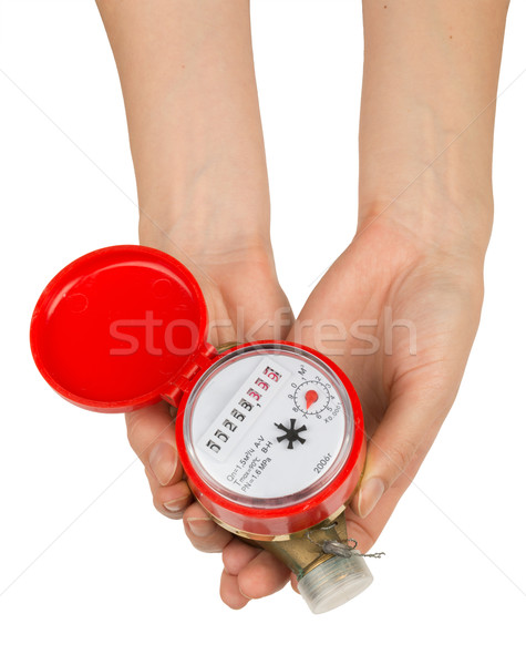 Stock photo: Womans holding water meter