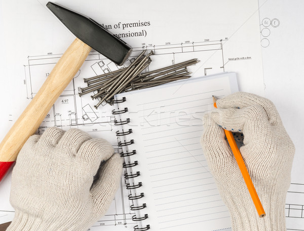 Humans hands with hammer, top view Stock photo © cherezoff