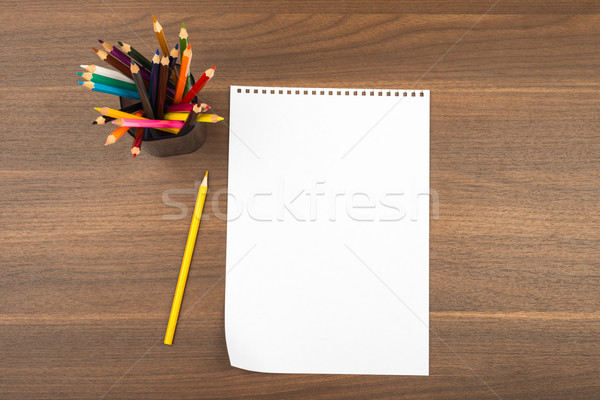 Blank note leaf with crayons Stock photo © cherezoff