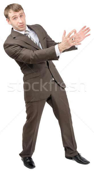 Surprised businessman holding empty space Stock photo © cherezoff