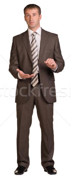 Businessman showing empty palm Stock photo © cherezoff