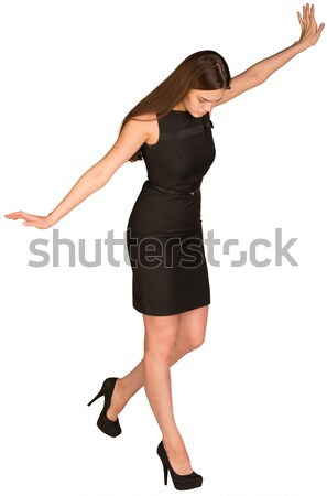 Businesswoman in dress looking down fearfully Stock photo © cherezoff