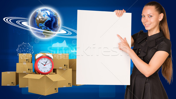 Businesswoman with Earth and heap of cardboard boxes Stock photo © cherezoff