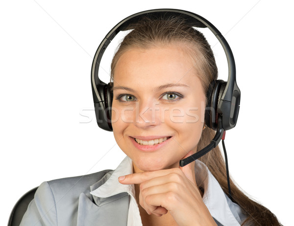 Zakenvrouw hoofdtelefoon vergadering stoel hand kin Stockfoto © cherezoff