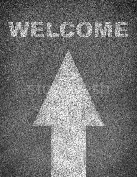 Stock photo: Asphalt road texture with arrow and word welcome